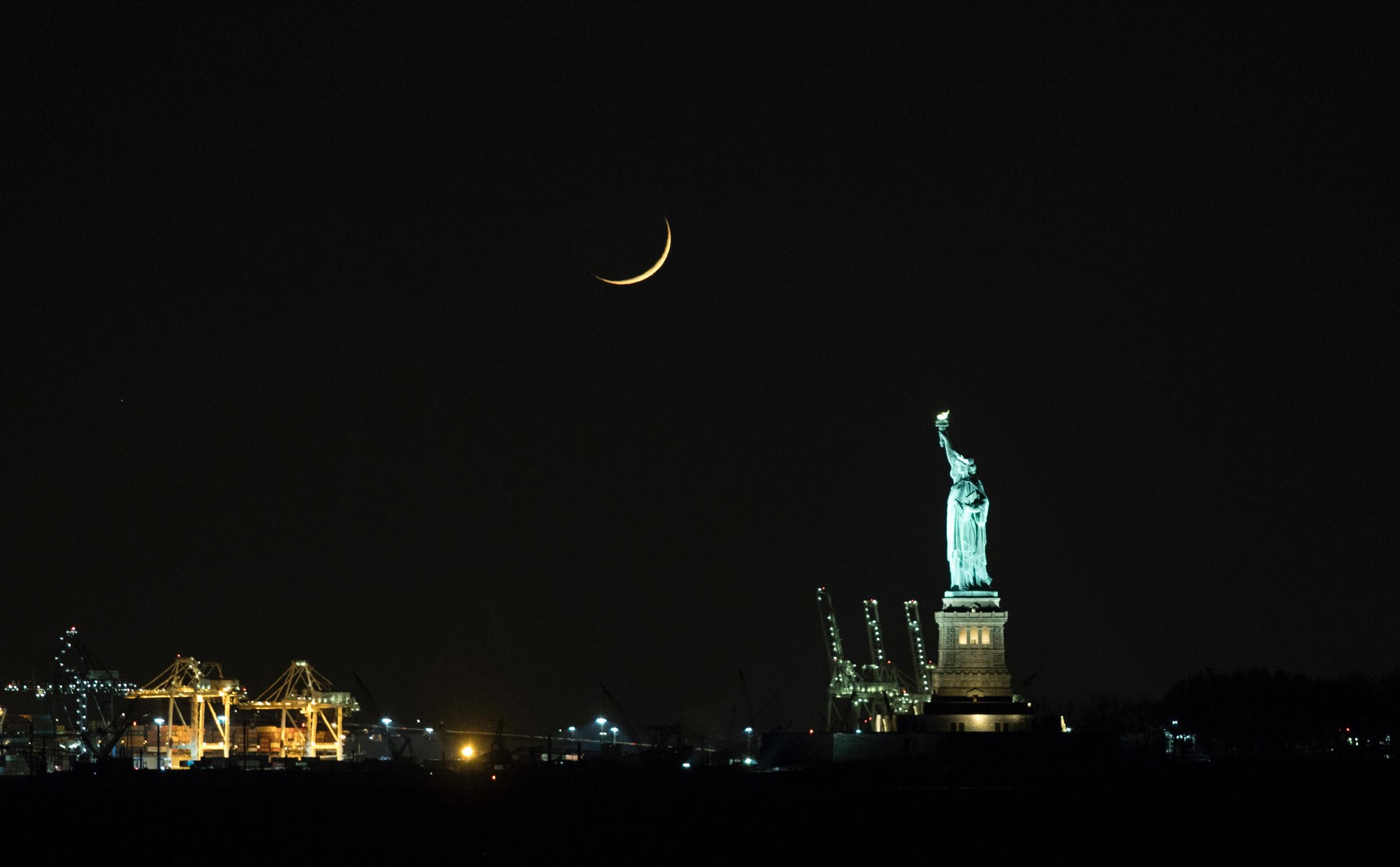 Crescent Moon over Statue of Liberty by John Bills